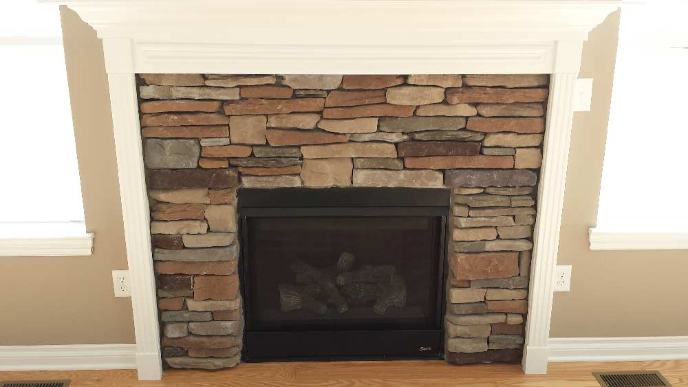 stone-fireplace-with-intricate-trim-detail